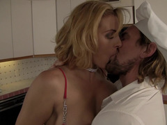 Blonde tastes some food and then she tastes a large cock in the kitchen