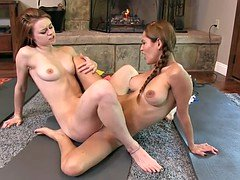 Lesbian babe in pigtails teases hot brunette's slit with a toy