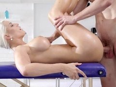 Blonde that loves to suck is doing it on the massage table