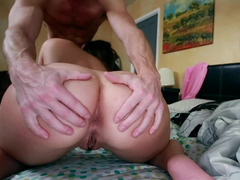 Big ass babe is getting fucked on the bed by a muscular guy