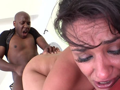 Gagging on the giant black cock that nails her wet pussy