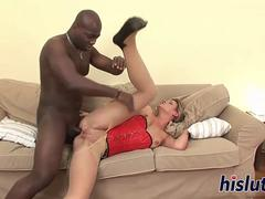 A blonde nympho milf is being pounded in her tight anal hole by a black monster cock