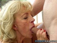Cute blonde granny sucks and rides a young prick
