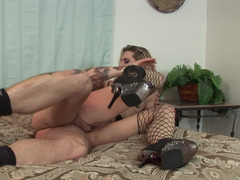 A blonde with her stockings and high heels is getting fucked hard