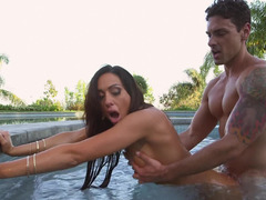 A girl is with her man in the pool, getting her pussy fucked