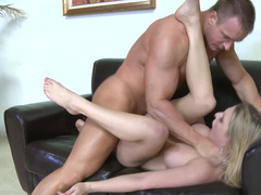 A blonde with big tits is getting fucked on the sofa and on the floor