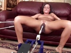 Big-breasted brunette plays with fucking machine