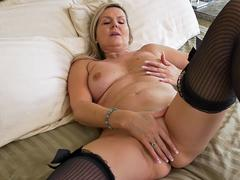 MAture blonde bombshell is teasing in front of webcam naked and starts playing with her favorite dildo