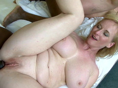 Amateur milfs in a hotel room suck and fuck two black strangers