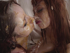 Two redhead lesbians have a food fetish and get covered with cream