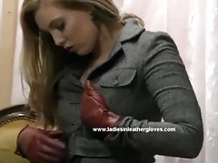 Naughty classy blonde puts on leather gloves and rubs pussy