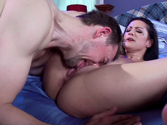A bitch with big tits is receiving a cock inside her ass and in her cunt