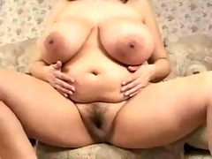 Sizeable titties on the chubby natural brunette