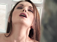 A brunette that has big natural tits is playing with her sexy pussy