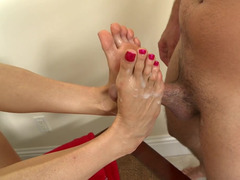 Brunette is using her sexy feet to get a guys dick hard