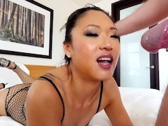 A petite Asian pornstar opens up her mouth and she sucks a cock