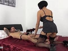 Sexy brunette Milf gives foot wank and handjob to nylon encased big throbbing cock