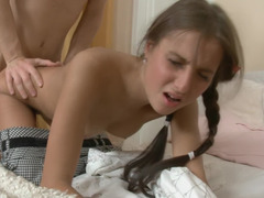 Skinny teen with pigtails is on the bed, getting humped hard