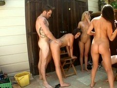 Fresh young babes are having an orgy in the back yard with guys