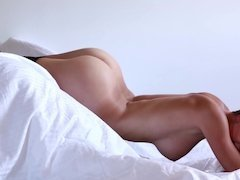 Solo erotic show by bewitching model in cozy bedroom