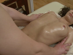 Slender bitch gets oiled up and used by her well endowed masseur