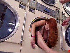 Busty cutie with red hair and natural breasts gets fucked in the laundry room
