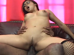 A black dude is shoving his cock into a hot Asian woman with black hair