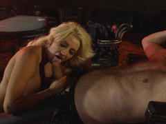 A blonde with long hair rides a cock in the cowgirl position