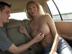Blonde MILF with juicy tits sucks guys tool in the car