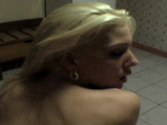 A blonde with small tits is getting penetrated by a large pecker