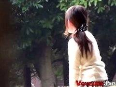 A voyeur watching Asian chicks on the street in skirts