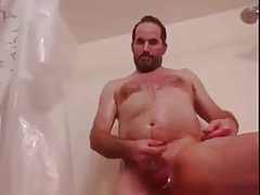 beareded dad takes a shower