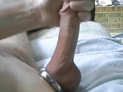 Stroking big shaved cock and balls cock ring
