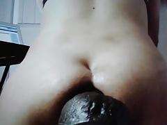 Tranny taking huge dildo deep on cam pt2