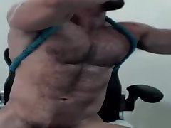 Muscle man enjoys jerking for his webcam