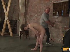 Lyle strokes his uncut dick after butt slapping and whipping