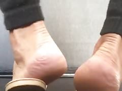 Cd arches soles view  & dangling feet in leather flip flops