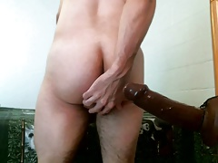 Sucking and fucked by black dildo