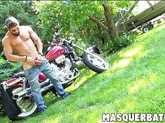 Zack is bearded muscular biker who is jerking off outdoors