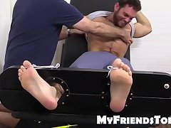Hot brunette hunk tied up and getting foot tortured for fun