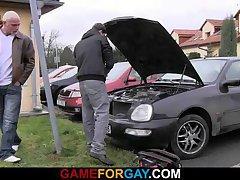 Car repair man is seduced by a big guy