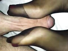 Girlfriends sexy footjob in Black Tights and painted nails.