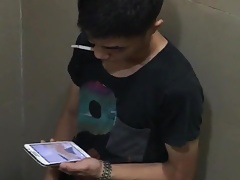 Asian boy caught jerking and cumming at the restroom
