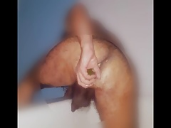 Sissy boy stabbing his butt with zucchini