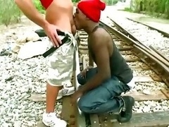 Black rookie thug sucks white cock outdoors