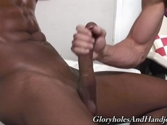 Handsome gay Zack Cook gives hand to a black poofter indoors