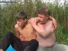 Fat Russian pervert plays with a twinks dick outdoors