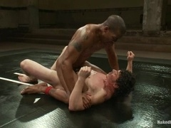 Jeremy Tyler and Scott Alexander play gay games during a fight on a ring