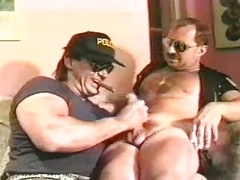 muscle bear cop giving blowjob