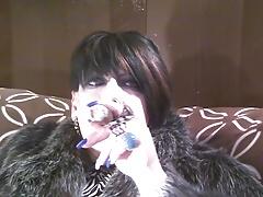 Fur and a cigar.